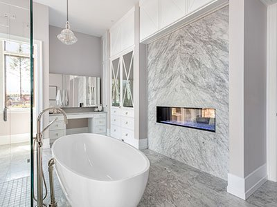 Modern master bathroom with freestanding tub and marble